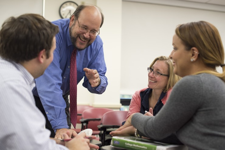A professor instructing students during a Continuing Studies class.