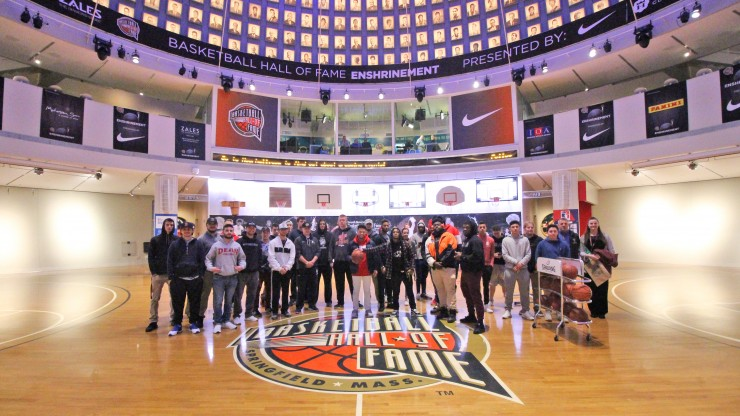 A group of students posing for a photo while on a tour of the Basketball Hall of Fame.