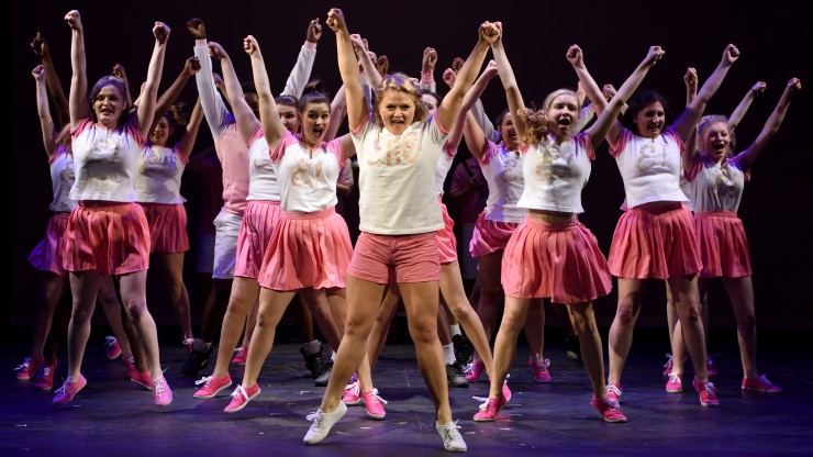 A group of theatre students performing in the Legally Blonde performance.