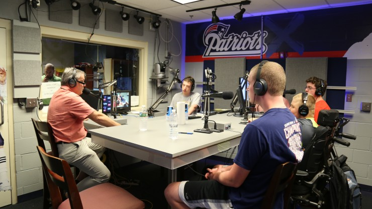 Students and a professor in the radio studio in Gillette Stadium receive hands-on experience broadcasting for the New England Patriots.