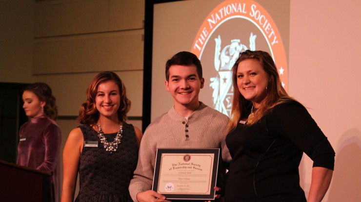 Student pictured with staff members at the National Society for Leadership & Success award ceremony.