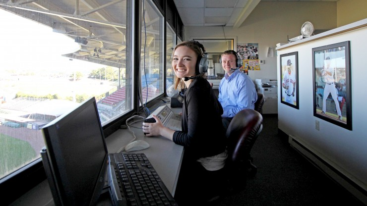 Two students sit in the press box at McCoy Stadium, home of the Pawtucket Red Sox.