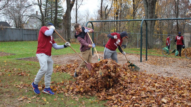 Students raking leaves at Nason Street park.