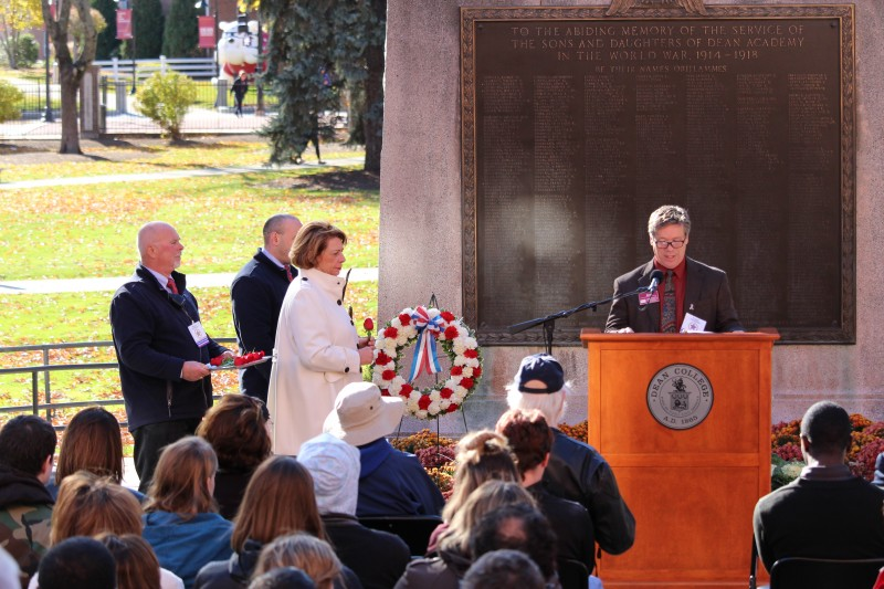 image of a crowd listening to a speaker at the dean college veterans day ceremony on campus.