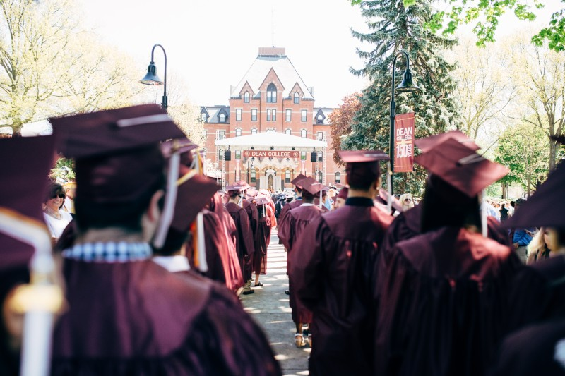 image of students wearing caps and gowns during the Dean College Commencement ceremony.