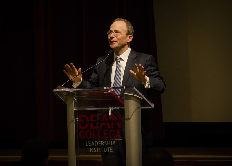 Image of Jonathan Kraft at the podium speaking during the dean leadership institute executive lecture event.