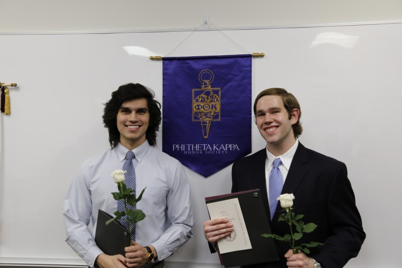 image of two students standing in front of banner during Phi Theta Kappa Honor Society event.