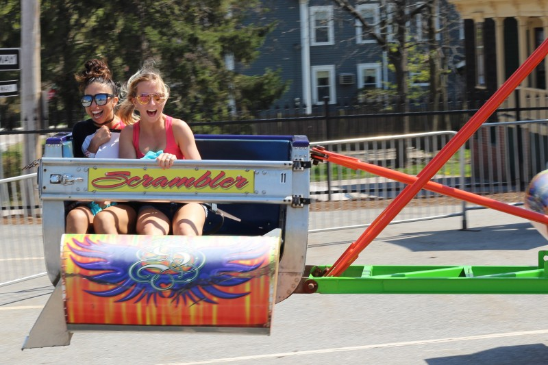 image of two students on a carnival ride during Spring Fling event.