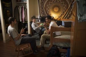 Students sitting in a double dorm room at dean college.
